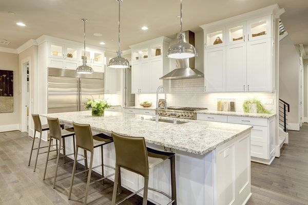 New modern kitchen remodel with white cabinets and island