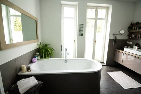Transitional bathroom remodel with pedestal tub and gray slate flooring
